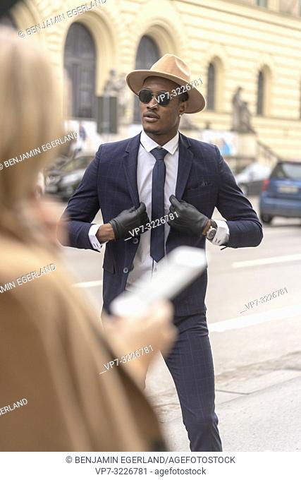 Fashionable man on the street, Munich, Germany