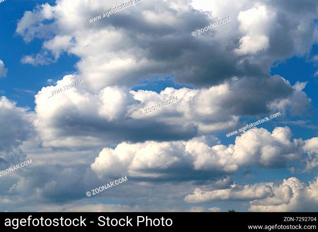 Beautiful white clouds photographed closeup against blue sky