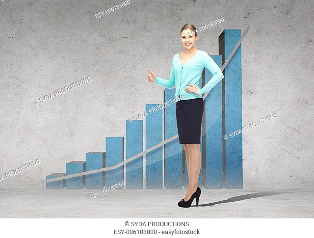 business, gesture and office concept - smiling businesswoman showing thumbs up with growing chart on the back