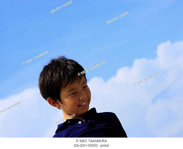 Low angle view of a boy smiling