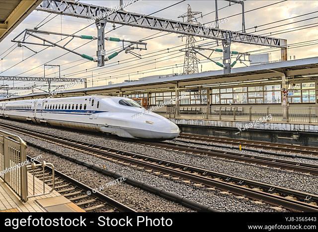 Tokaido Shinkansen train running through Odawara Station, Japan