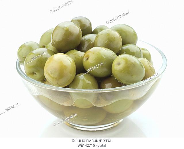 several bowls of homemade olive oil on white background