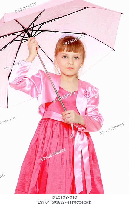 A beautiful little girl is 6 years old, with a short bangs and a big white bow on her head. In a red satin dress and a pink jacket