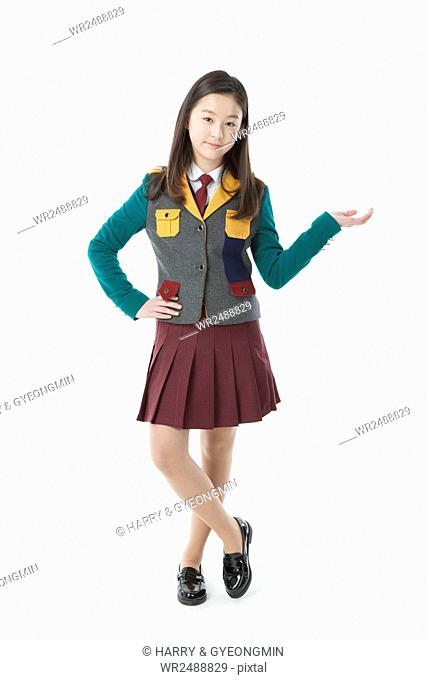 Smiling middle school girl in school uniform posing