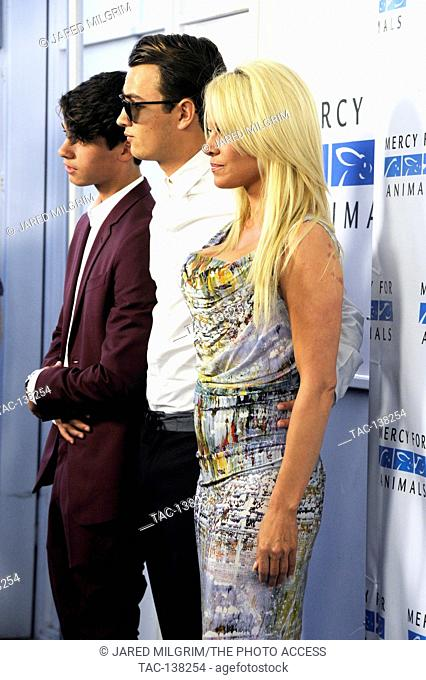Pamela Anderson with sons Brandon Lee (r) and Dylan Lee (l) attend the Mercy For Animals Hidden Heroes Gala at Unici Casa on August 29th