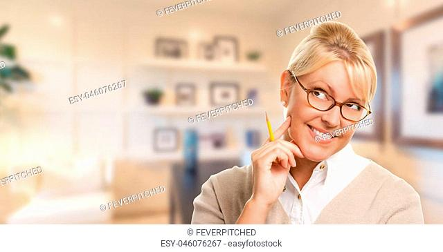 Beautiful Expressive Student or Businesswoman with Pencil in Office