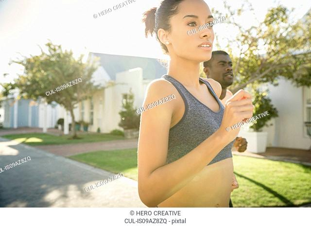 Couple jogging in residential area