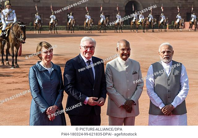 24 March 2018, India, New Delhi: German President Frank-Walter Steinmeier ..(2nd from left) and his wife Elke Buedenbender (L) being received with military...