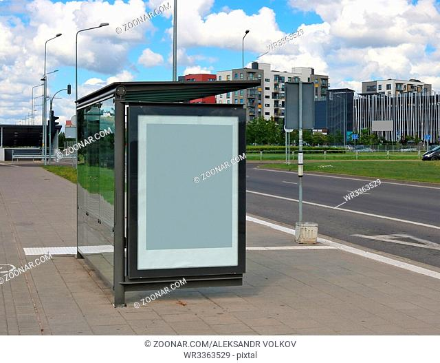 The empty mass production bus-stop near highway in the small european city