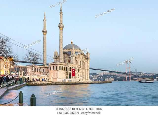 Exterior view of Ortakoy Mosque with15 July Martyrs Bridge or unofficially Bosphorus Bridge also called First Bridge over bosphorus in Istanbul,Turkey