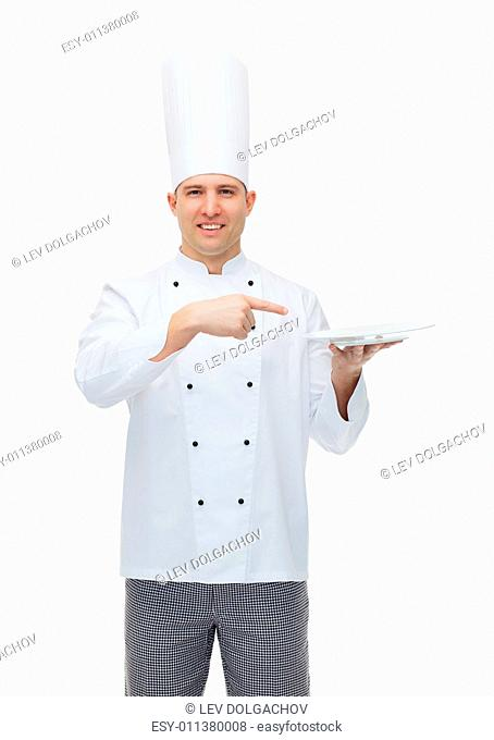 cooking, profession, advertisement and people concept - happy male chef cook showing something on empty plate