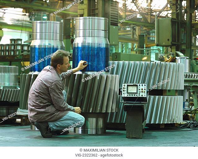 TECHNICIAN CHECKING GEAR WHEEL FOR A ROLLING MILL GEAR THROUGH ULTRASONIC TESTING, - 01/01/2010