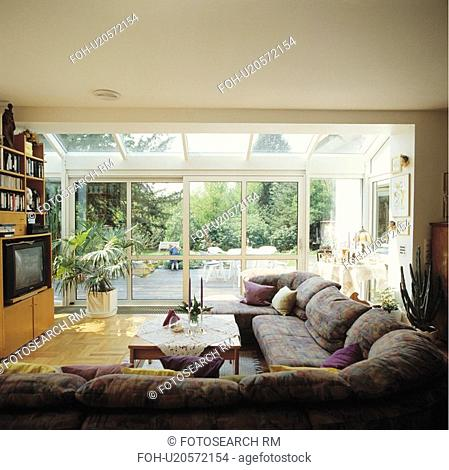 Grey Sofa In Modern Living Room With Glass Extensions