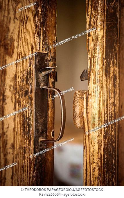 Old handmade wooden door at Pournaria village, Arcadia, Greece