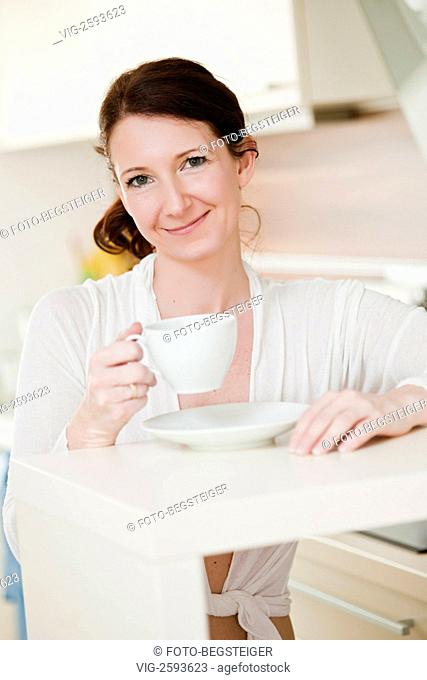 woman relaxing at home with a cup of tea - 15/04/2011