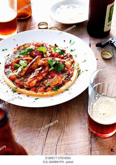 Barbecue chicken pizza on white plate