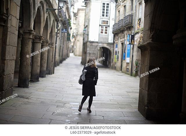 Girl walking, Santiago de Compostela, Galicia, Spain