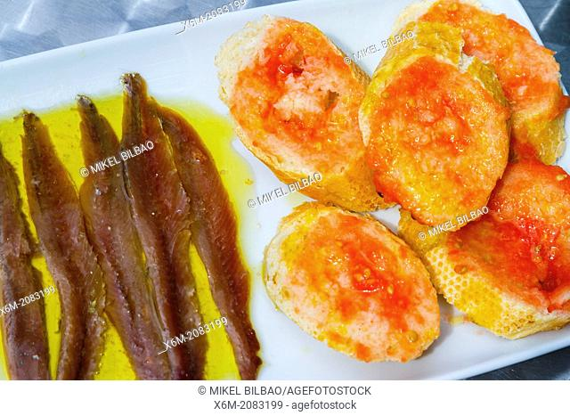 Pan con tomate (bread and tomatoes) and anchovies. Catalonia, Spain, Europe