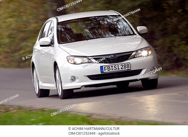 Subaru Impreza 2.0R Sport, model year 2007-, driving, diagonal from the front, frontal view, country road
