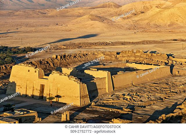 Aerial view of the Mortuary Temple of Ramesses III at Madinat Habu at sunrise, Luxor, New Valley Governorate, Egypt