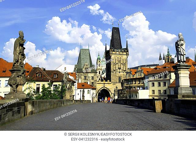 View on towers and sculptures of Charles Bridge in Prague