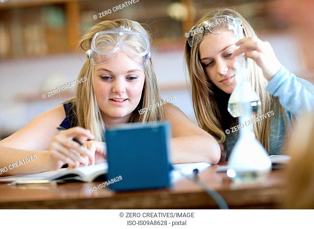 School girls enjoying science lesson