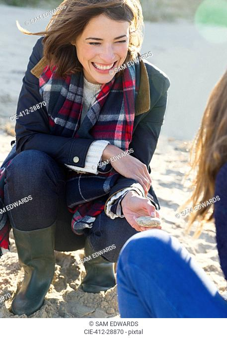 Smiling woman clamming on beach