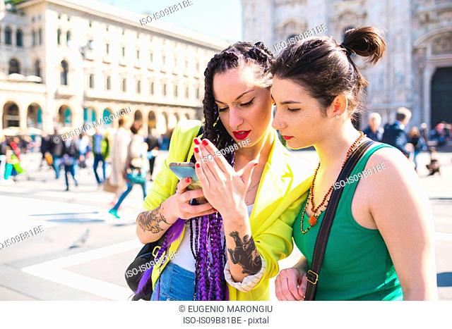 Women outside Il Duomo, Milan, Italy