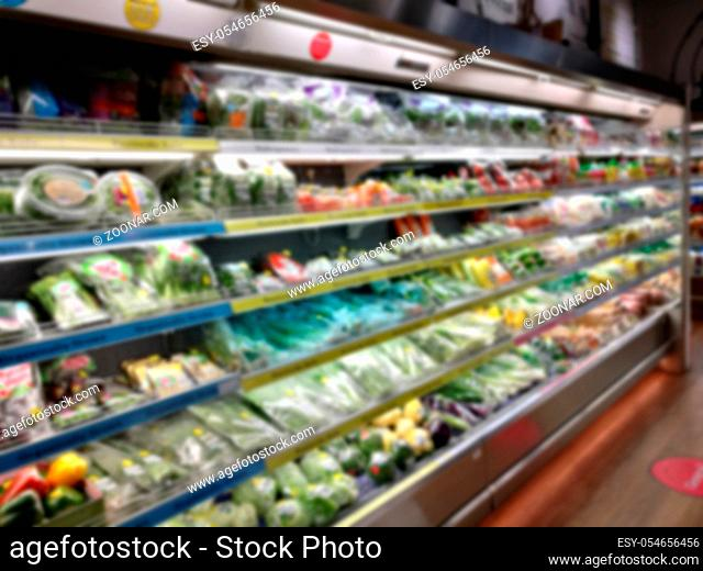 Blurred of product shelves in supermarket or grocery store, use as background