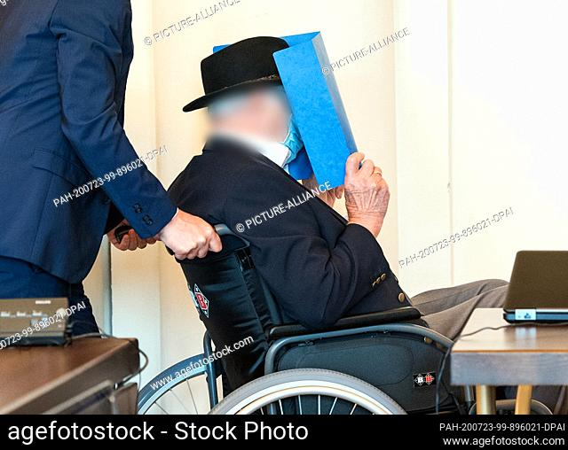 23 July 2020, Hamburg: A 93-year-old former SS guard of the Stutthof concentration camp near Danzig is pushed into a courtroom in the regional court