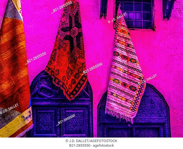 """Morocco, Meknes, berber carpets on exhibit on a wall in the """"Medina"""" (old part) of Mekness"""