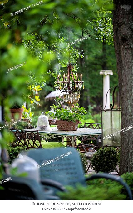 An outdoor living space in a garden with furniture