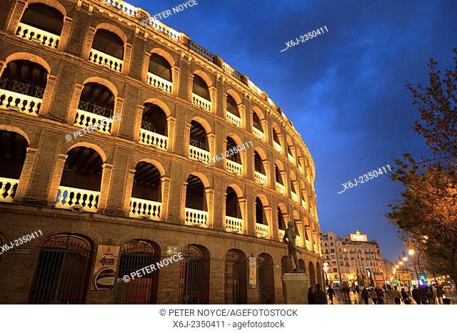 Exterior of the Bullring Plaza de Toros Valencia lit up on a wet rainy night