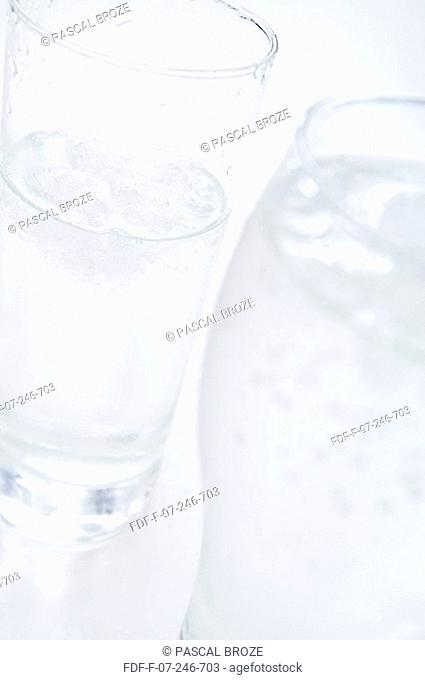 Close-up of two glasses of purified water with ice cubes