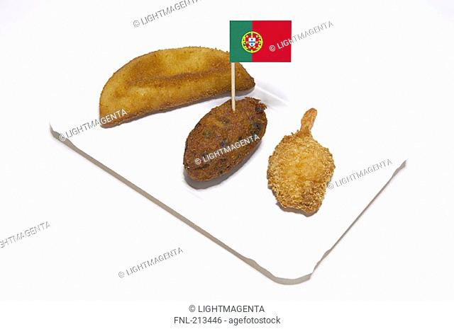 Close-up of fried food and Portuguese flag