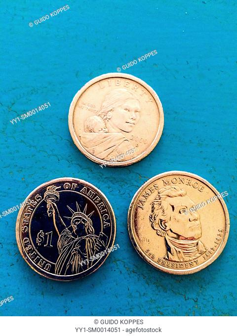 Tilburg, Netherlands. Three US Dollar coins on a table, after a trip to the United States of America