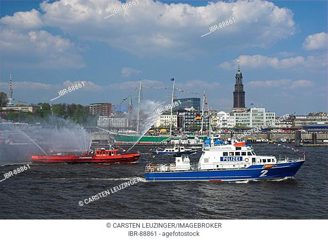 A police boat and a fire boat in Hamburg during the 817th anniversary of Hamburg Harbour, Hamburg, Germany