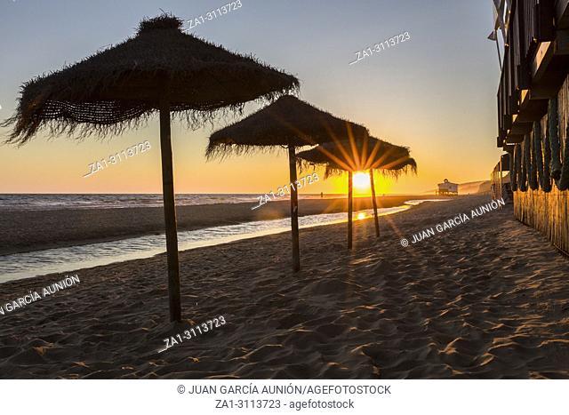 Sunset landscape at spanish coast beach. Costa de la Luz seashore, Matalascanas, Huelva