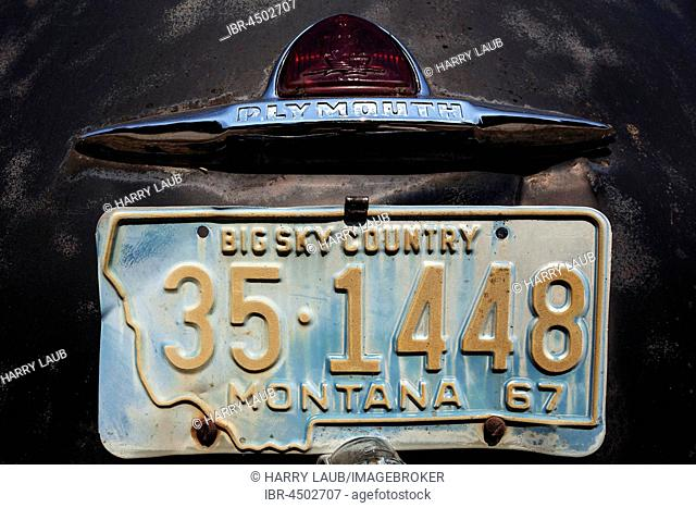 Detail, Montana license plate in 1967 and Logo, Vintage Plymouth, scrap car, Washington, USA