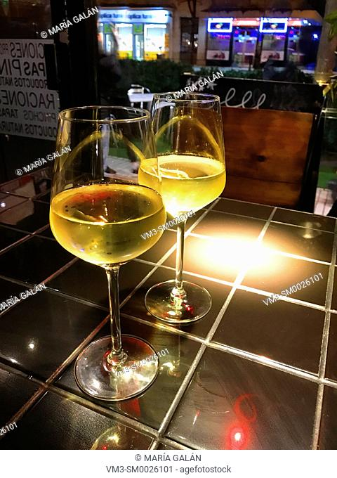 Two glasses of white wine in a bar