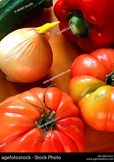 Tomatoes, onion, red pepper and courgette. Still life