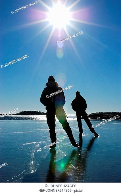 Scandinavia, Sweden, Stockholm, Couple ice skating