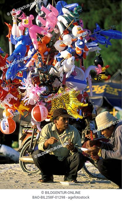 A balloon trader on the beach of Sihanoukville in the gulf of Thailand in sueden from Cambodia in southeast Asia
