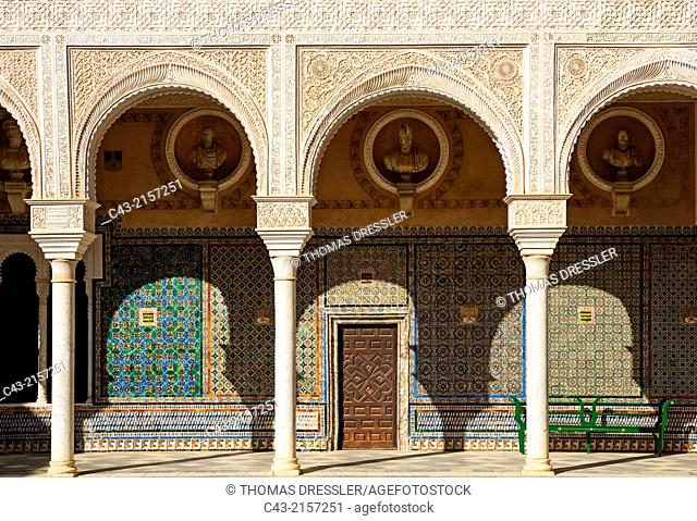 Highly artistic decoration in the main courtyard of the Casa de Pilatos, one of Seville's finest mansions. Seville, Seville province, Andalusia, Spain