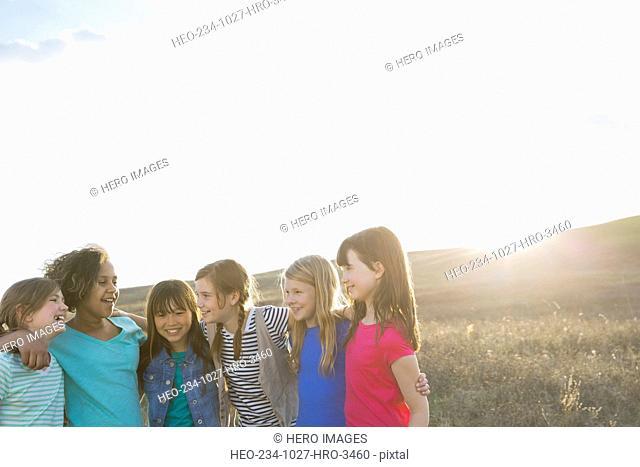 Schoolgirls talking during field trip