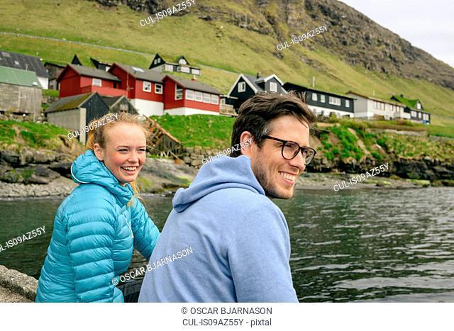 Happy couple by lake, Vagar, Faroe Islands