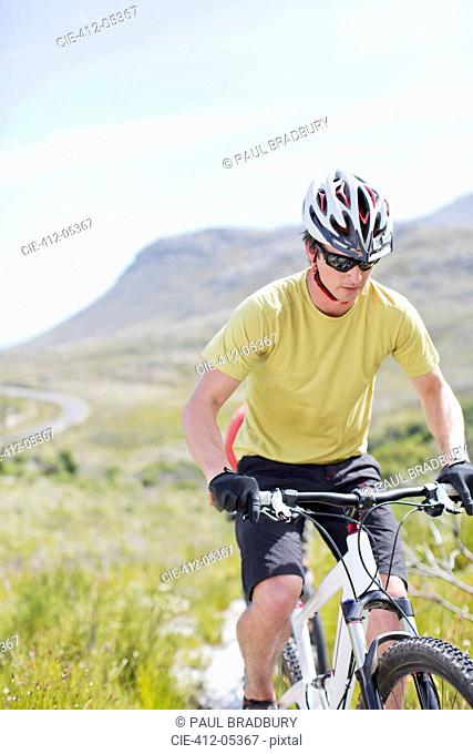 mountain biker on dirt path