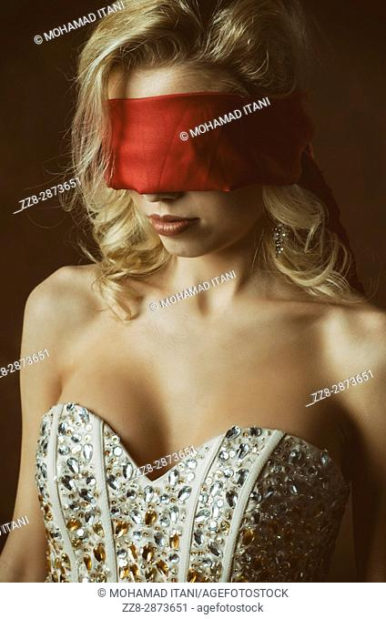 Blindfolded blond woman