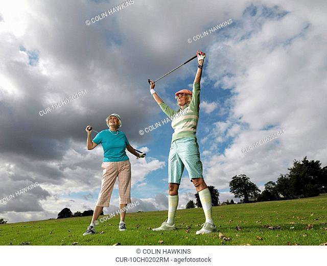 Mature ladies preparing to playing golf