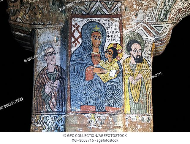 The virgin with child between Abuna Esi (right) and and unknown figure to her left, fresco at a column in the orthodox rock-hewn church Abuna Yemata , Gheralta
